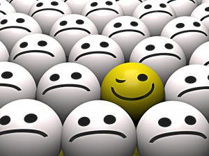 A winking yellow smiley stands out from the crowd